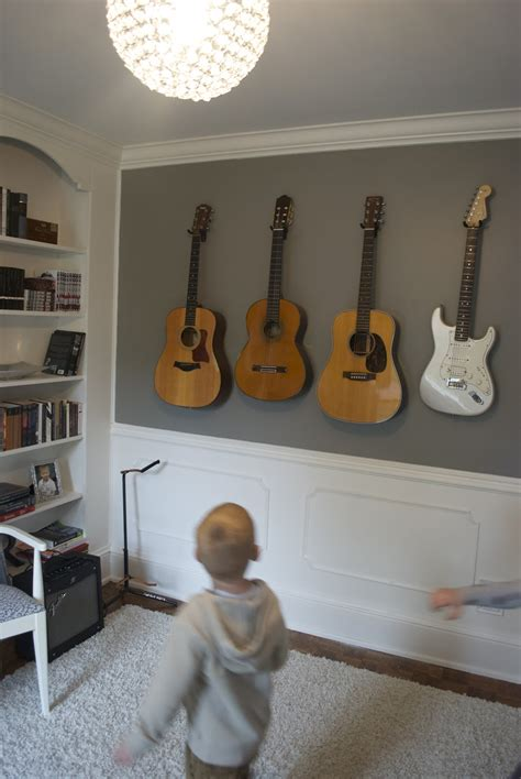 how to hang a picture on the wall how to hang your guitars or other instruments on the wall
