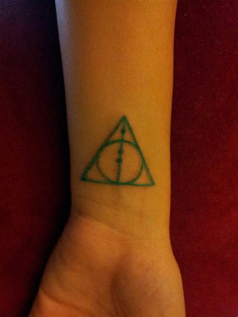 teal tattoo deathly hallows symbol aqua teal tattoos