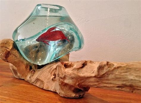 blown recycled glass fish bowl melted