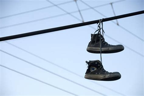 hanging photos on wire hanging converse in mexico for some bizarre reason i