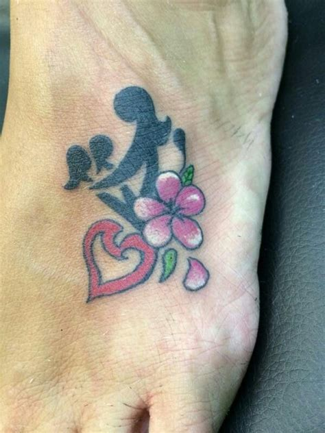 motherhood symbol tattoo designs and two tattoos