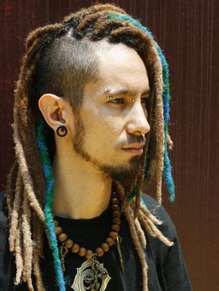 mahawk with soft dread hairstyles for blacks love the undercut with blue wrapped dreads awesome hair