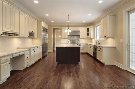 kitchen with wood floors and white cabinets pictures of kitchens traditional two tone kitchen