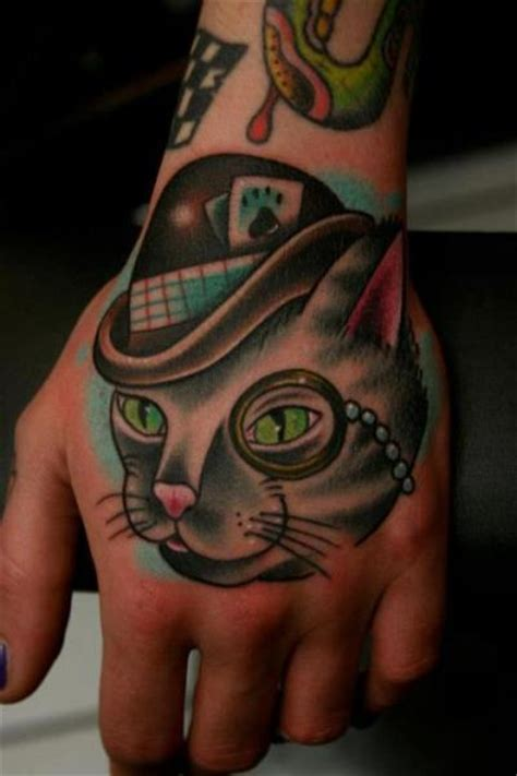 tattoo new school hand fantasy new school hand cat tattoo by carnivale tattoo