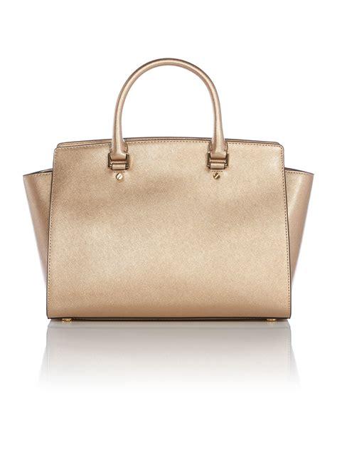 michael kors selma gold metallic large tote bag in gold lyst