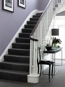 purple walls white trim dark brown black furniture and