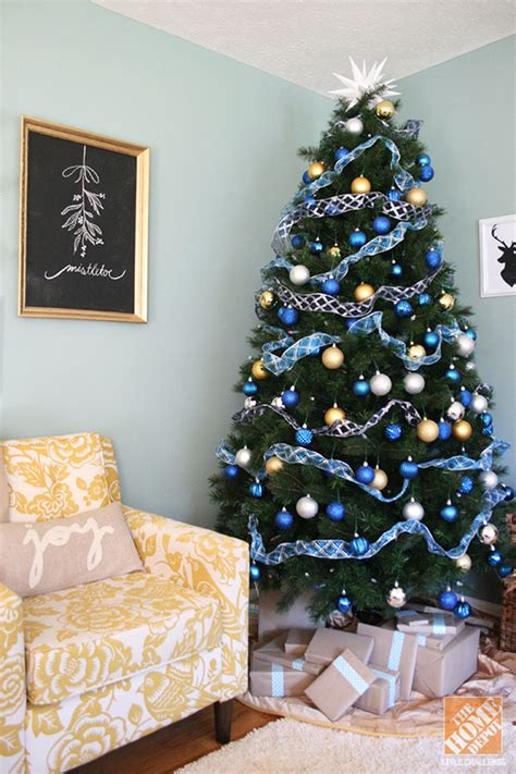 decorating for christmas with gold blue and gray decorating trees and coffee cups