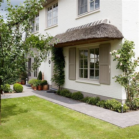 house front design ideas uk front garden with clipped lawn paths and thatch front