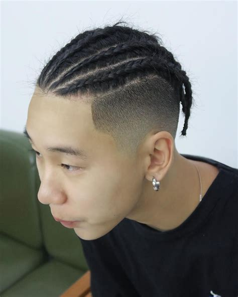 hair braided on the top but cut close on the side clean fade with twisted braids hairstyles for chinese man