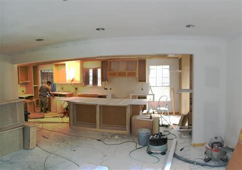 removing a wall between kitchen and living room real food in rock hb s new kitchen