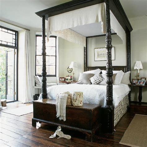 colonial style beds bedroom with four poster bed and dark wood furniture