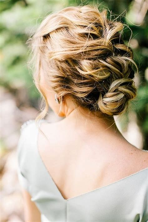 hairbuns on pinterest french braid buns updo and updos soft waves with loose braid and a bun at the nape of the