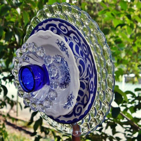 plate flowers garden garden flower blue glass plate flower garden yard