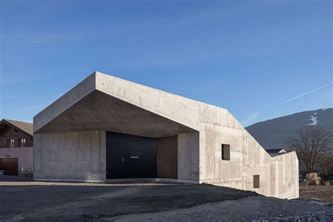 concrete house designs concrete home climbs up small sloping site in switzerland