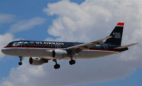 Black Airbus us airways flies into the sunset finalizing the merger with american airlinegeeks