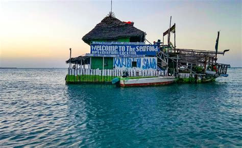 floating boat zanzibar looking for a peaceful destination go visit zanzibar