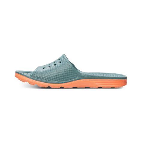 nike slide on sandals nike benassi solarsoft slide sandals in green for lyst
