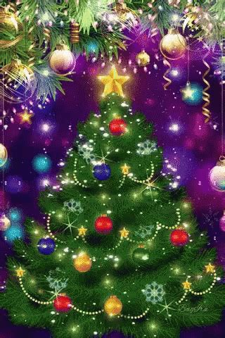 excited christmas tree gif excited christmastree sparkle discover share gifs