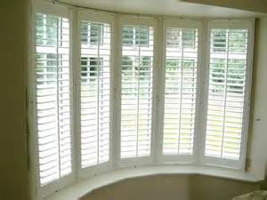 ideas about bay window blinds pinterest treatments panel bow shutters solar shades