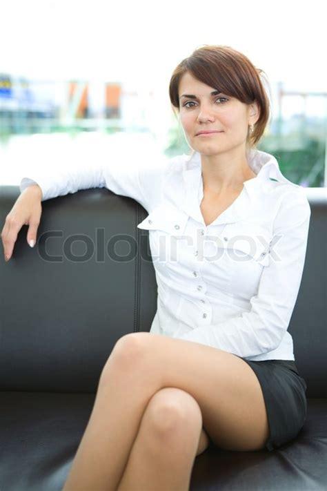 facesitting on sofa businesswoman head of business sit on skin sofa stock