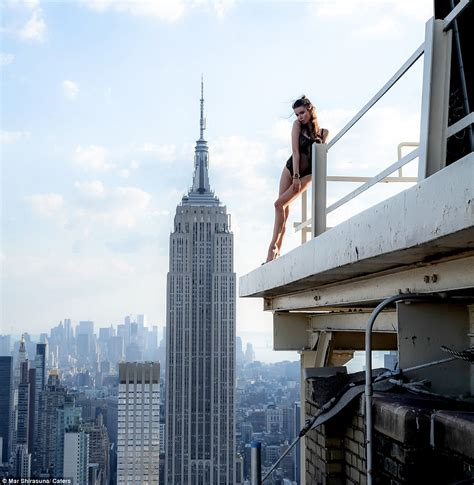 and nyc models pose perilously to the edge of