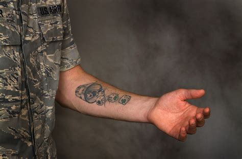national guard tattoo policy air to review its policy