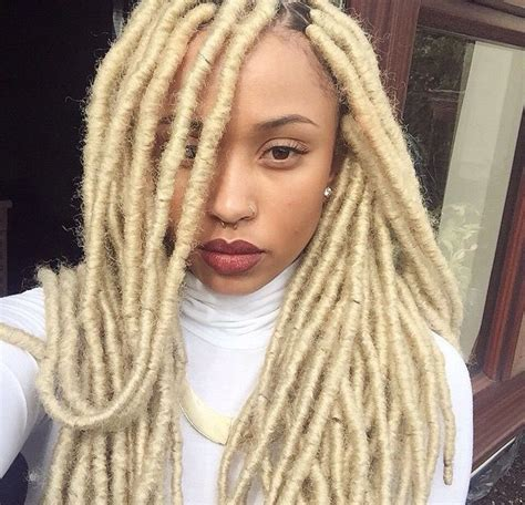 platinum blonde and blue crochet marley her blonde faux locs look soo good hair inspo