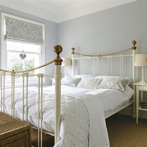 pale blue bedroom  traditional white bed frame