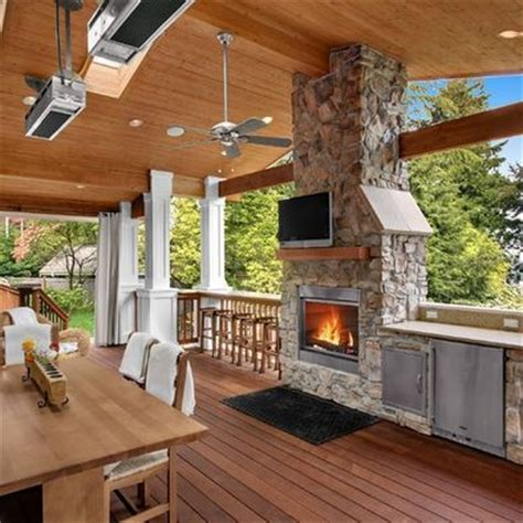 outdoor fireplace and beautiful deck future home ideas