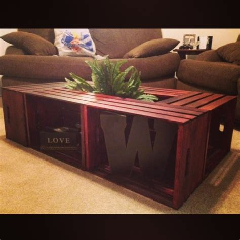 coffee table made with wooden crates add legs to