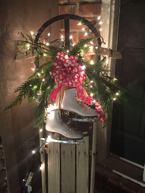 weihnachtsdekoration schlitten wooden sled decor made with fresh greenery lights