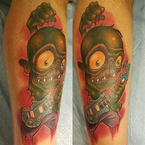 rockstar tattoo pictures rockstar zombie tattoo on forearm
