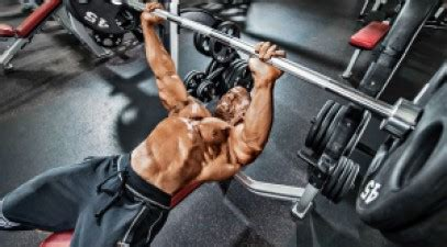 bench pressing a person training mistakes the guide to a better bench press and fewer injuries muscle fitness