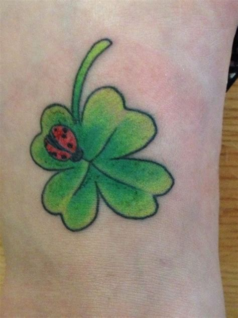 four leaf clover tattoo meaning my new four leaf clover with a ladybug tattoos