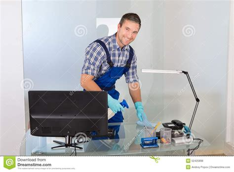 best cleaner for office desk male janitor cleaning desk stock photo image 52425898