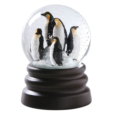 exclusive what on earth musical penguin snow globe plays
