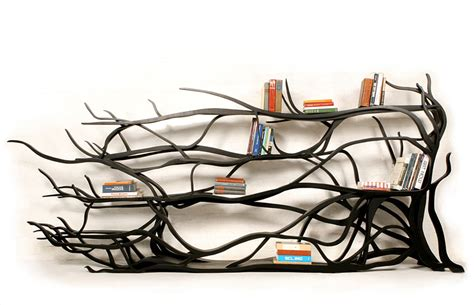 artist finds fallen branch makes a book shelf