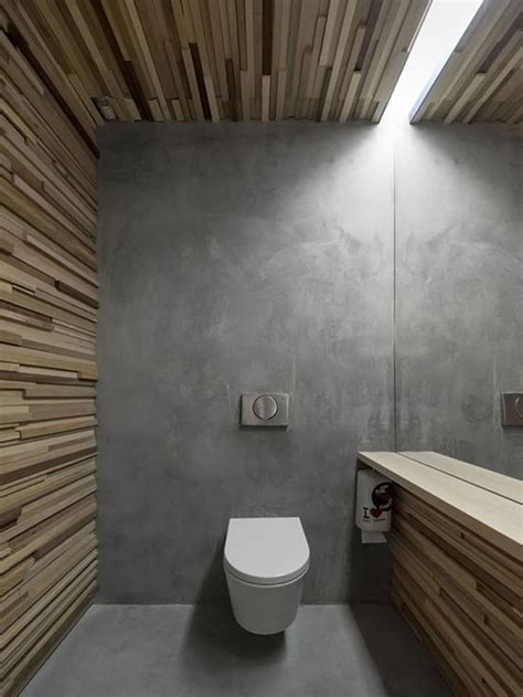 polished concrete floor bathroom contemporary wc with wood paneled walls and polished