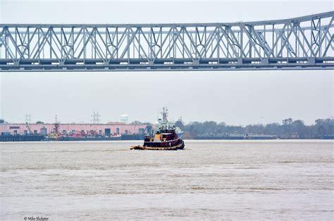 tugboat new orleans tugboat sailing down mississippi river under the crescent