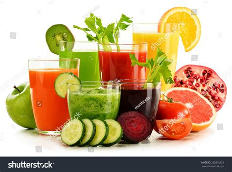 Simple Fruit And Veggie Detox Diet by Glasses With Fresh Organic Vegetable And Fruit Juices