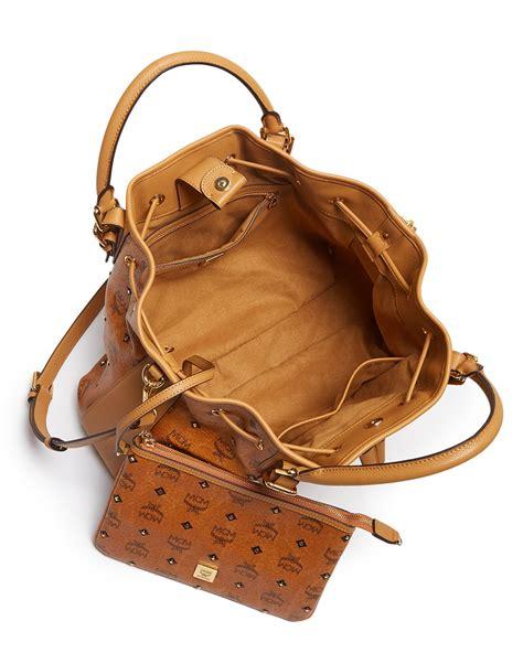 mcm shoulder bag gold visetos drawstring in brown lyst
