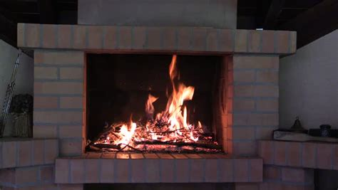 Hd Fireplace Loop by Two Wine Glasses Is Highlighted By The Fireplace