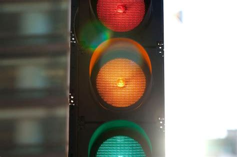 why are the lights in traffic signals always in order why some traffic light buttons don t actually do anything