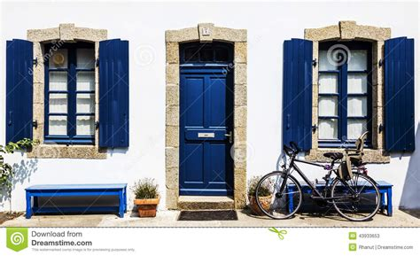 blue house with a blue window a white country house with blue frame stock photo image 43933653