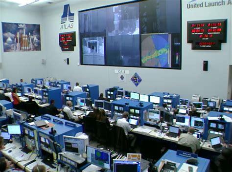 United Flight engineers in atlas launch control center nasa
