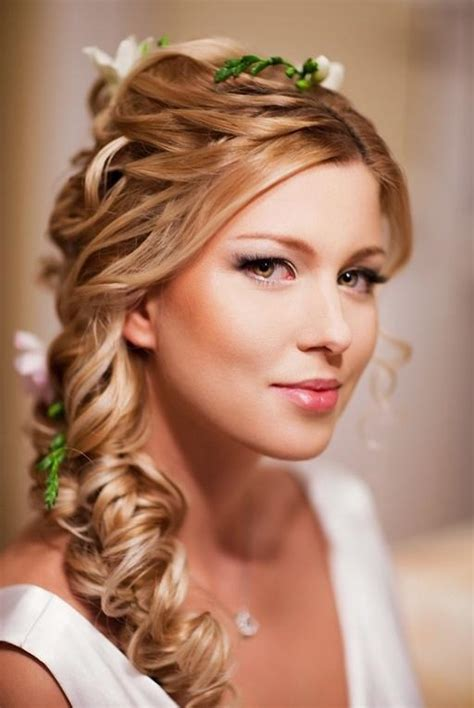 wedding side braided hairstyles with pink flower detail 1912902 weddbook