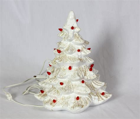 white ceramic christmas tree red bulbs and gold glitter