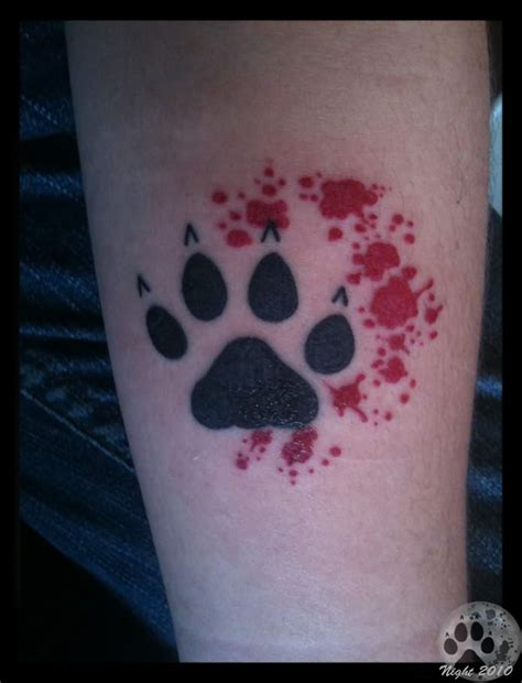 blood tattoo blood paw on arm
