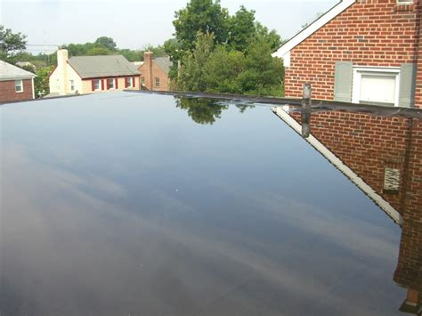 everything you need to know about flat roofs from construction to repairs jj roofing supplies