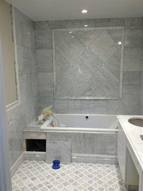 marble tiles bathroom carrara marble soap niche shelf in a subway shower with